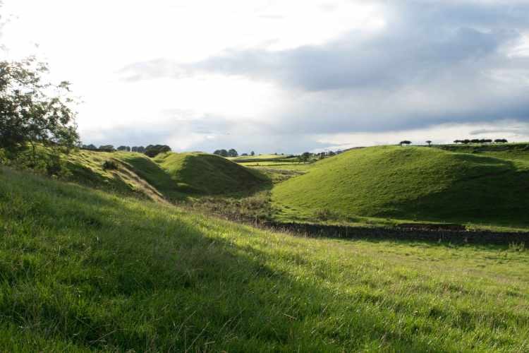 Deep ditch and mounds]