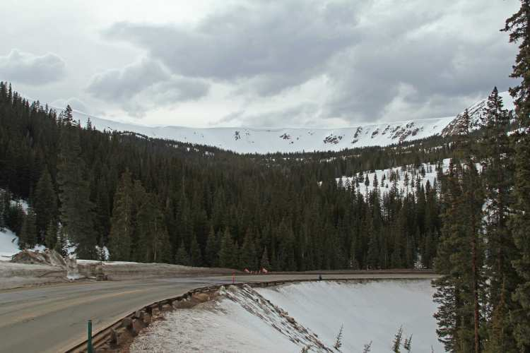 This bowl, on the west side of Berthoud Pass, is ringed by frozen white waves of cornices.